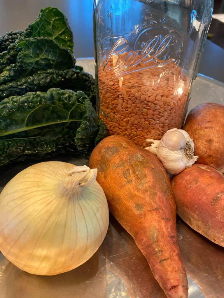 sweet potoato, lentils, kale, onion, garlic, carrot