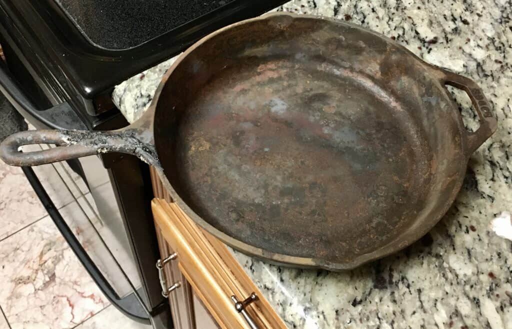 Cast iron skillet pulled from the ashes